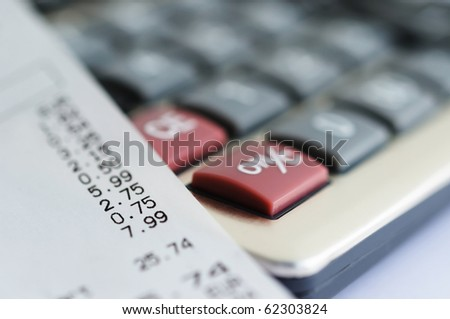 Bill from shop and calculator closeup image - stock photo