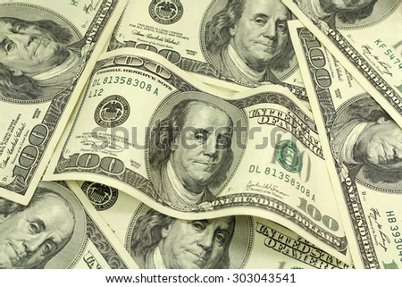 bill hundred dollars on money background - stock photo