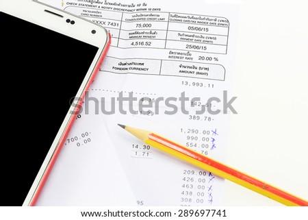 Bill, mobile phone and pencil - stock photo