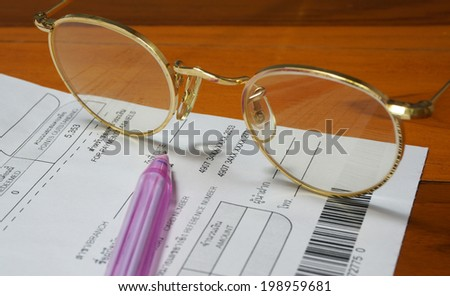 Bill monthly expenses to be paid, on the table for estimated cost at the end of the month.                             - stock photo