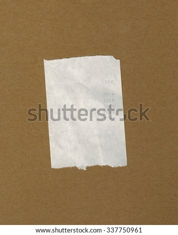 bill or receipt isolated over brown background - stock photo