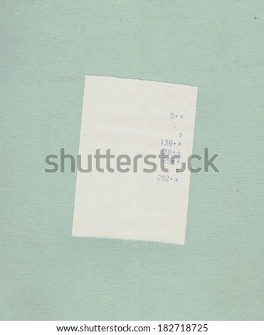 bill or receipt isolated over light blue paper background - stock photo