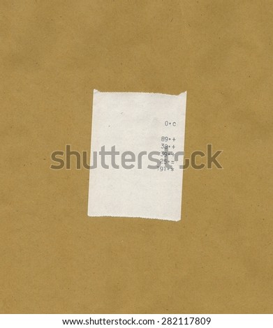 bill or receipt isolated over light brown background - stock photo