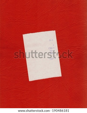 bill or receipt isolated over red background