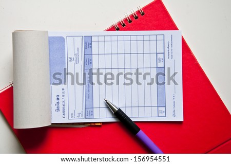 Bill with pen on notebook isolated on a white background.  - stock photo