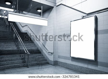 Billboard and direction signage mock up in subway with stairs - stock photo