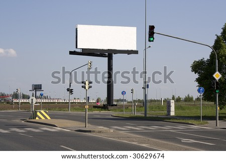 Billboard at a junction in suburb
