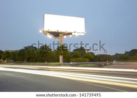 Billboard at night light trails - stock photo