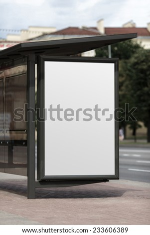 Billboard at the bus stop. Clipping path. Shallow depth of field. - stock photo