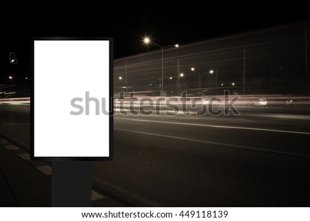 Billboard, banner, empty, white at a bus stop on the highway during the twilight with city background with clipping path on screen.- can be used for display your products or promotional