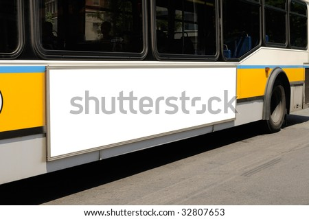 Billboard close-up on side of the bus. Outdoor advertising. - stock photo