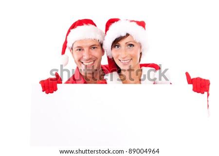 billboard holding christmas couple - stock photo