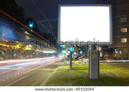 Billboard in the city street, blank screen clipping path included - stock photo