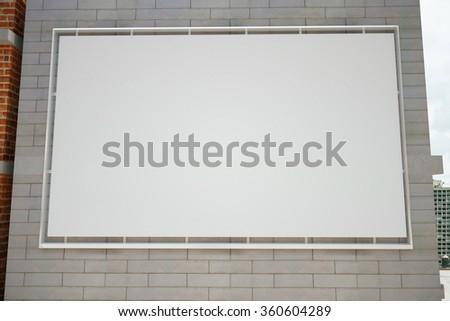 Billboard on a brick wall, mock up - stock photo