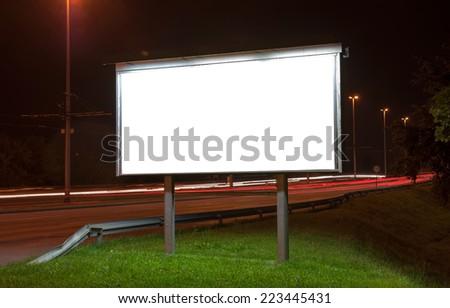 Billboard on highway by night in Zagreb - stock photo