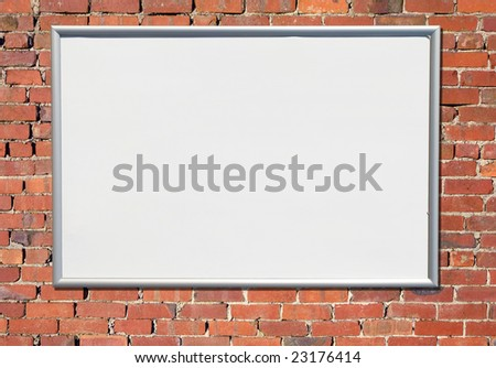Billboard sign on an old red brick wall. - stock photo