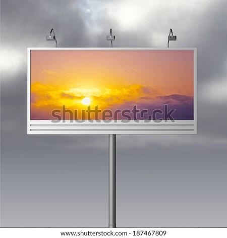 Billboard with beautiful sunset, close up - stock photo