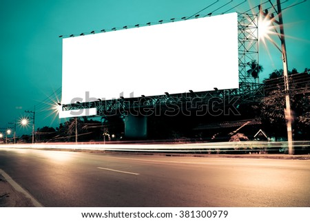 billboard with traffic light and road
