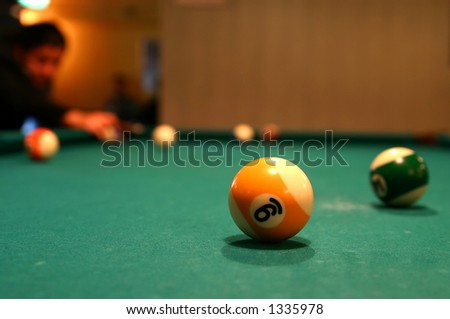 Billiard ball number nine close-up