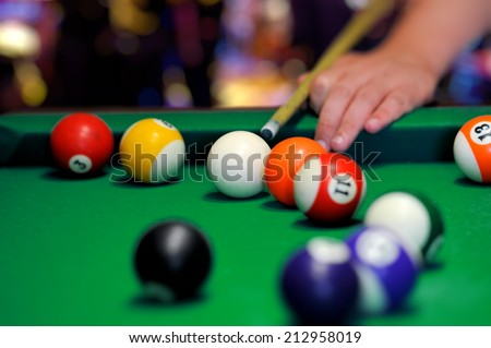 Billiard balls in a green pool table - stock photo