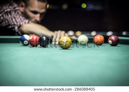 Billiard balls in a green pool table - stock photo