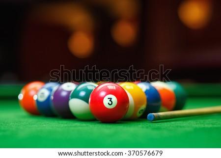 Billiard balls in a green pool table, game - stock photo