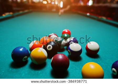 Billiard balls in a pool table after shoot - stock photo