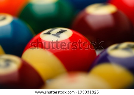 Billiard balls in box, selective focus over number 11 - stock photo