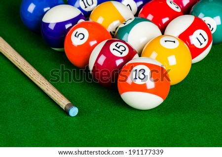 billiard balls on green table - stock photo