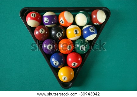 Billiard balls on green table