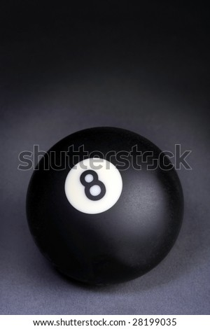 Billiard Eight Ball on Black Background ready for type. - stock photo