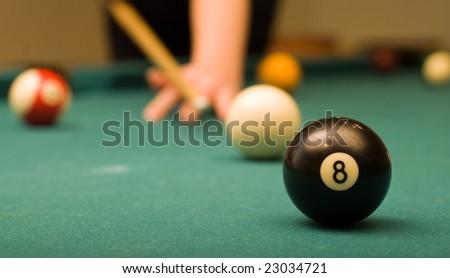 Billiard game (black ball in focus) - stock photo