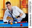 Billiard handsome player man drinking some alcohol in club - stock photo