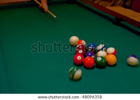 Billiard table, first hit of the game, motion blur on the balls - stock photo
