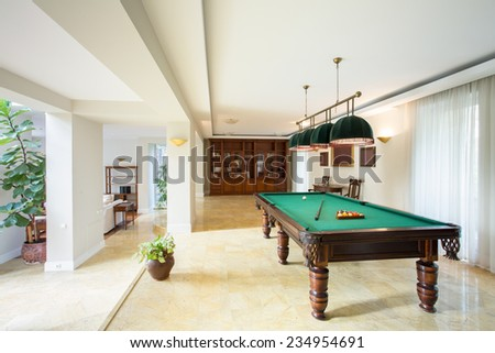 Billiard table in living room in luxury apartment - stock photo