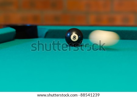 Billiard - the cue ball strikes the black