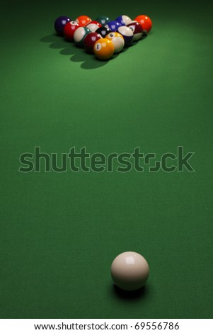 Billiard time! Table, balls and cue - stock photo