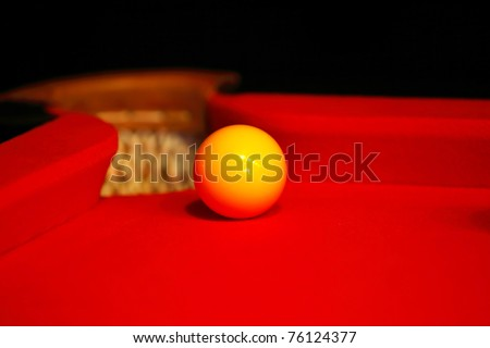 Billiard yellow ball on a red cloth - stock photo