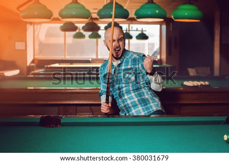 billiards player wins an important match. American pool billiard. Pool billiard game. Billiard sport concept. - stock photo