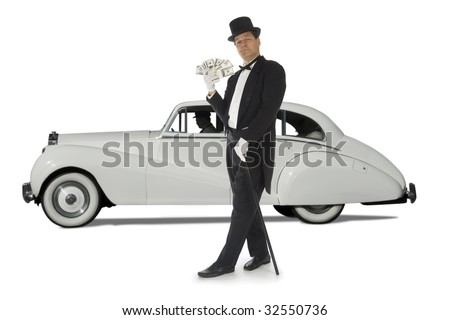 Billionaire standing in front of a vintage car against a white background - stock photo