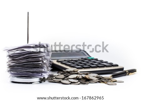 Bills in paper nail with coins, pen and calculator - stock photo