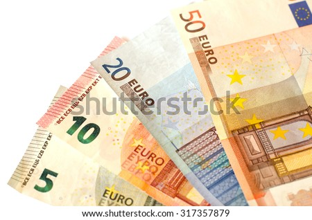 Bills nominal value of five euros EUR 5, ten euros EUR 10, twenty euros EUR 20 and fifty euros EUR 50 white background of banknotes - stock photo