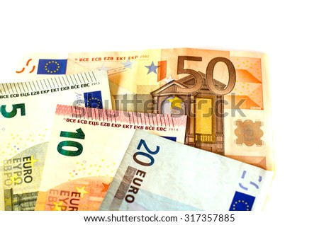Bills nominal value of five euros EUR 5, ten euros EUR 10, twenty euros EUR 20 and fifty euros EUR 50 white background of banknotes. - stock photo