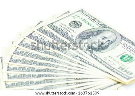 Bills one hundred dollars on white background. - stock photo