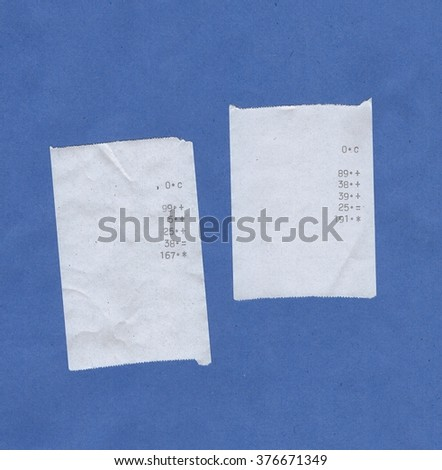 Bills or receipts isolated over blue background - stock photo