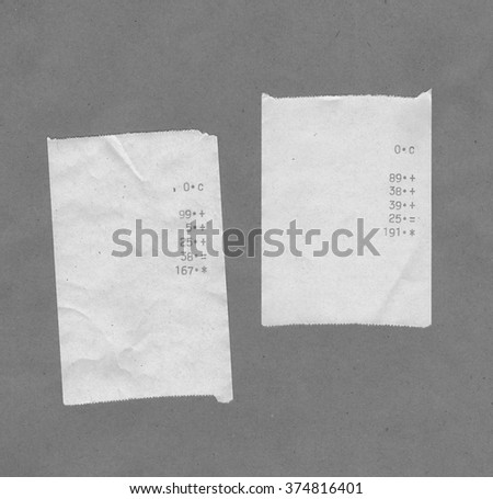 Bills or receipts isolated over grey background