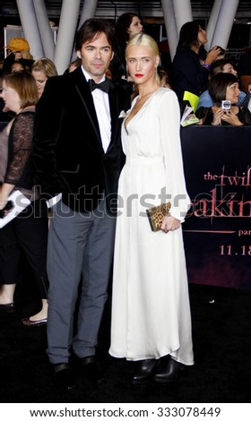 Billy Burke and Pollyanna Rose at the Los Angeles premiere of 'The Twilight Saga: Breaking Dawn Part 1' held at the Nokia Theatre L.A. Live in Los Angeles, USA on November 14, 2011. - stock photo