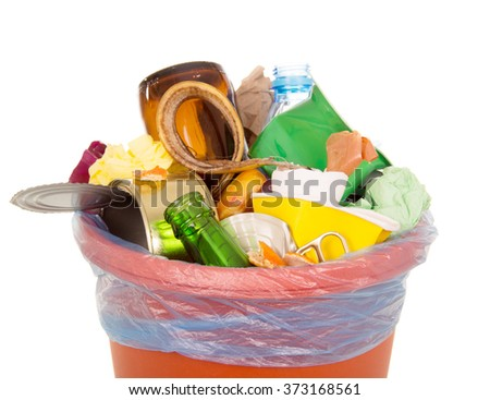 Bin completely filled with household waste isolated on white background - stock photo
