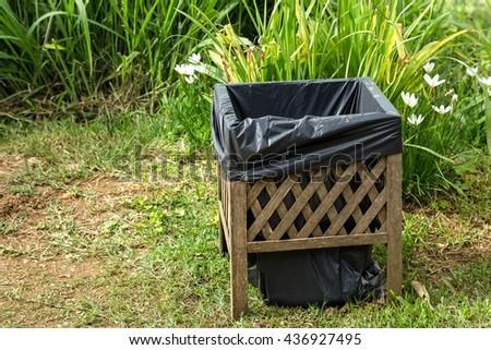 Bin in the garden - stock photo