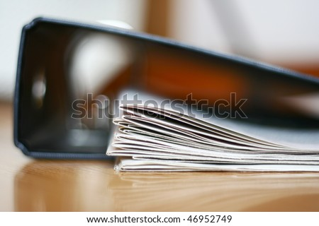 binder and documents - stock photo